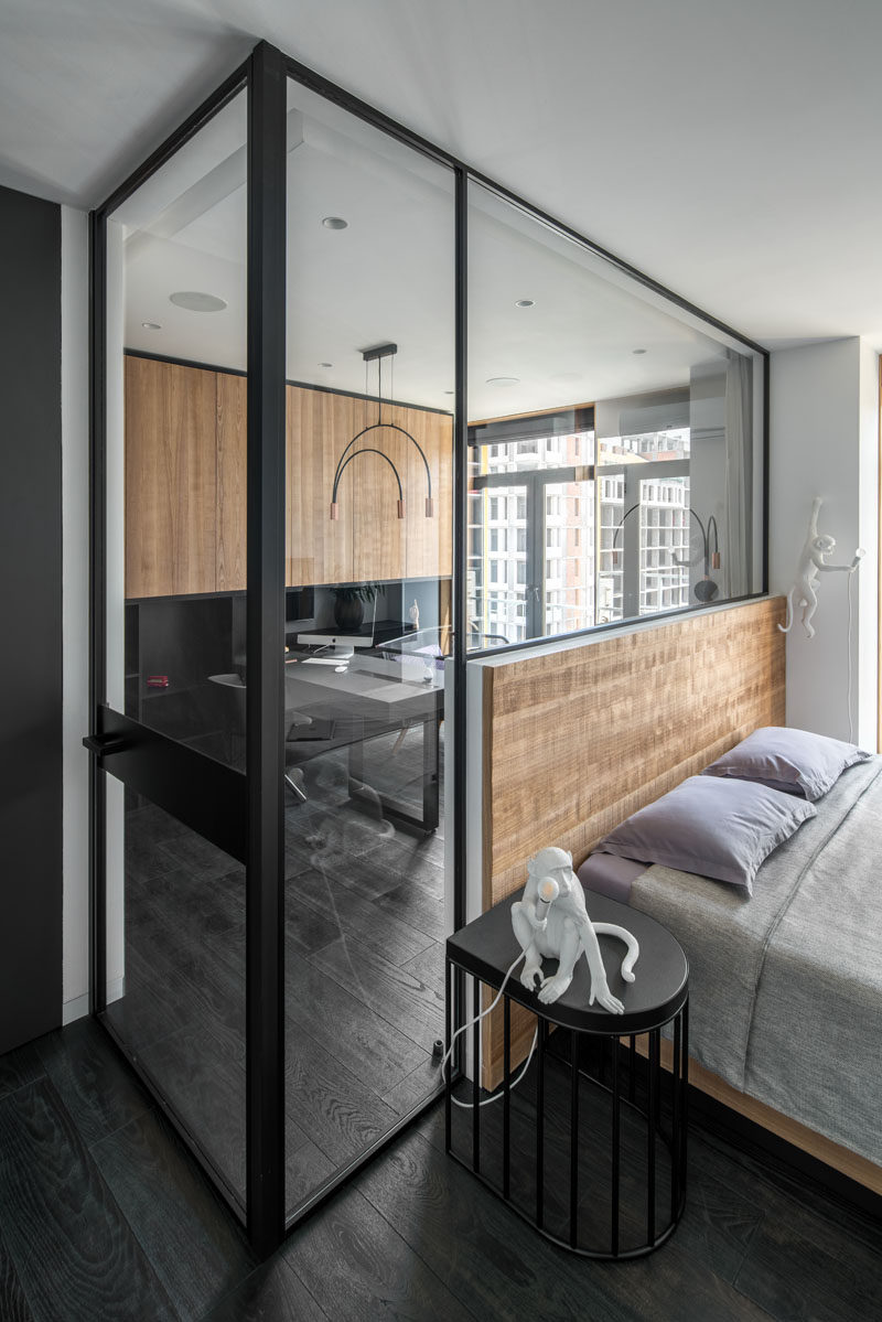 In this modern bedroom, a glass partition has been used to separate the home office from the sleeping area. #ModernBedroom #GlassPartition #HomeOffice