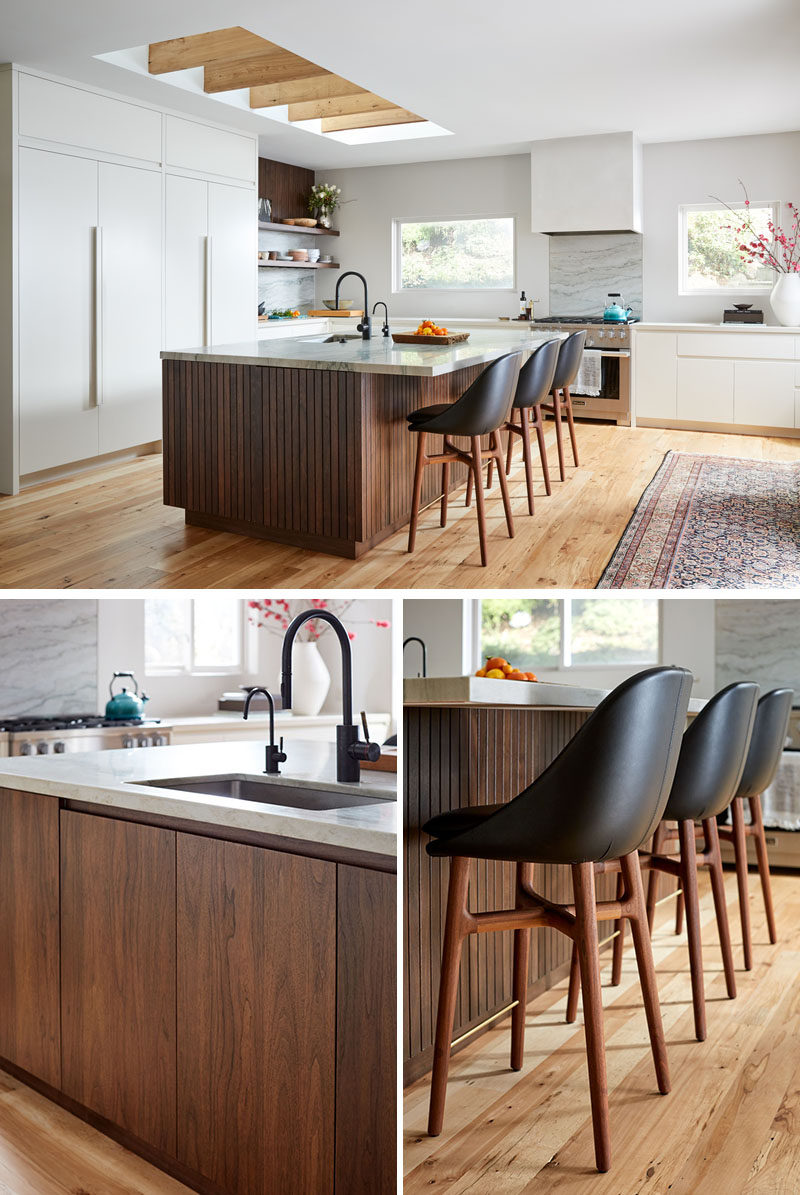 This modern kitchen utilizes sleek, bright cabinetry, and various wood tones to keep the space grounded and warm.#ModernKitchen #KitchenDesign #WoodKitchenIsland