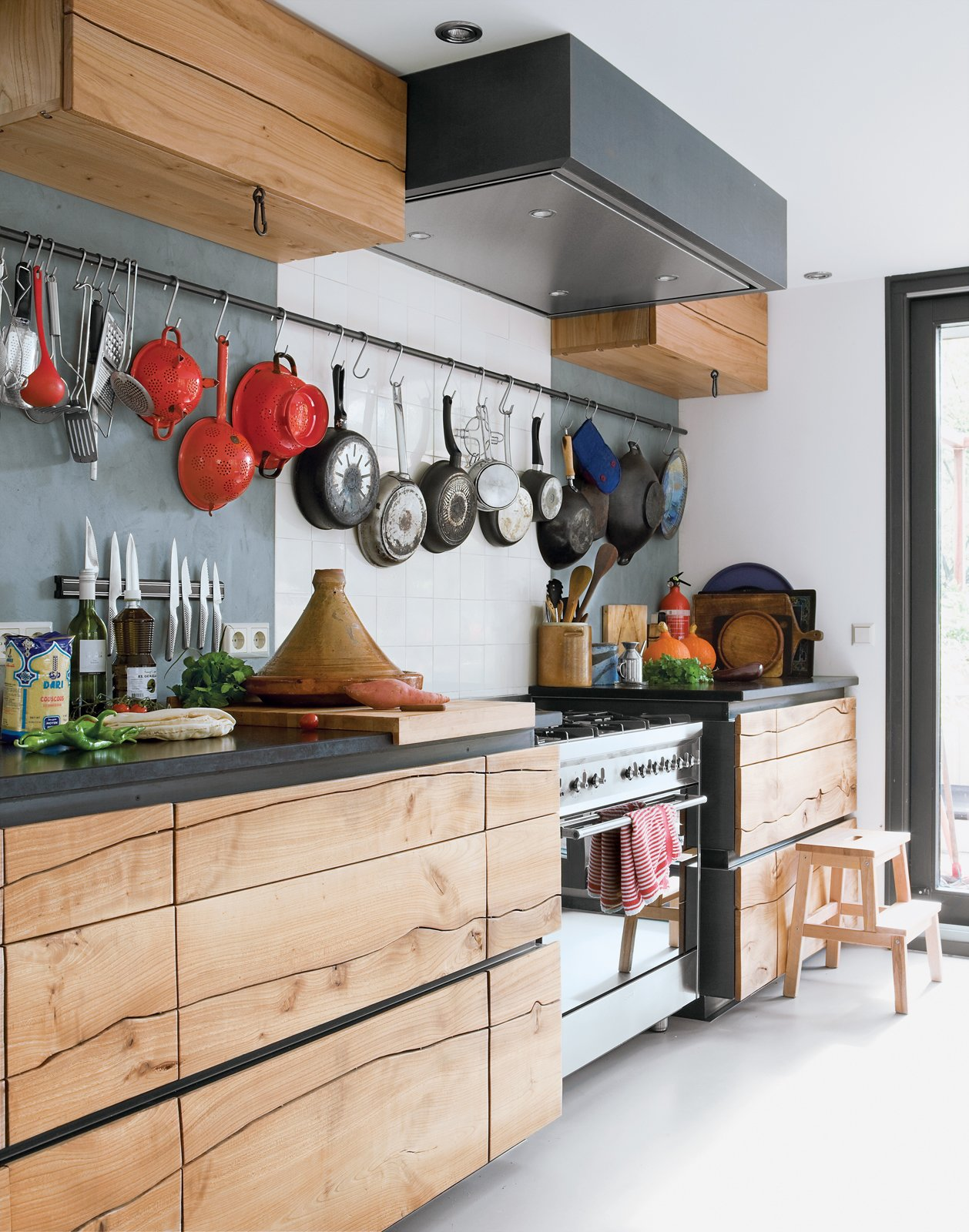 The original stain of wood cabinets can fade, yellow, or discolor over time, and varnish can also change in color and texture. A good sanding and new stain, oil, or other treatment can give old wood cabinets a new life—but it takes some work!