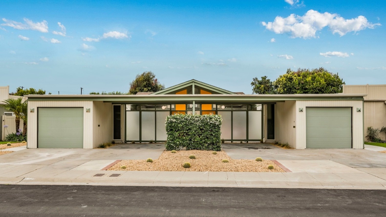 Located in Long Beach's Los Cerritos/Virginia Country Club neighborhood, the duplex occupies a 7,306-square-foot lot.