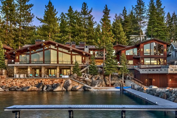 The midcentury mansion has panoramic views of Lake Tahoe and the surrounding mountains.