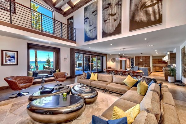 Images of Dean Martin, Frank Sinatra, and Sammy Davis Jr. adorn the double-height great room.