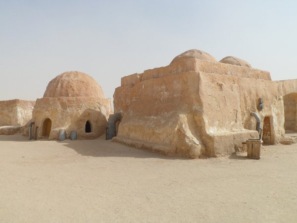 These Tunisian Berber dwellings are low-set and cave like, providing cool interiors that protect from the hot desert climate.