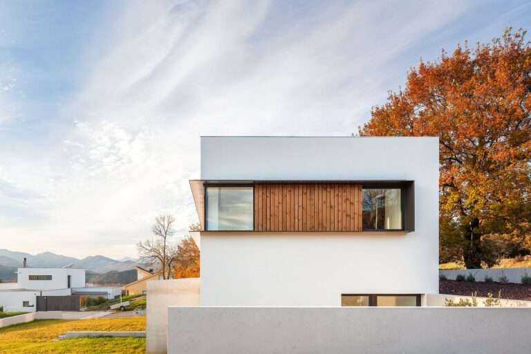 Modern Family Home in White and Wood in a City of Volcanoes