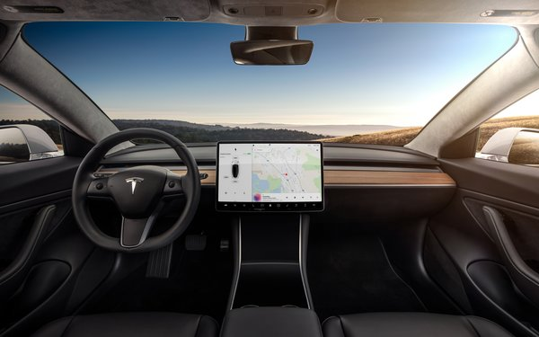 A view from inside Tesla's Model 3 shows the car's sleek, streamlined interior.