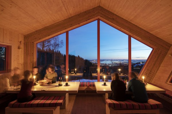 A panoramic, south-facing window offers spectacular views of Oslo.