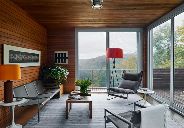 The penthouse guest suite features breathtaking views and minimal furnishings.