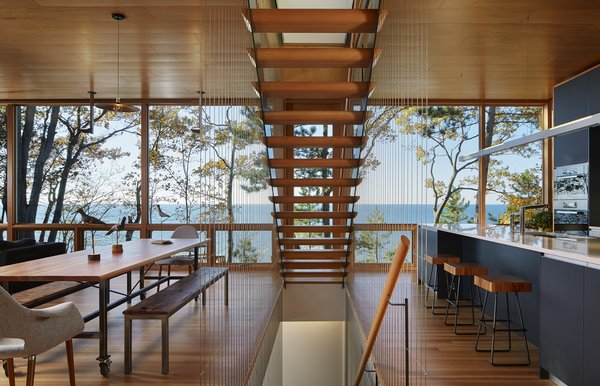 The material palette of Suns End Retreat includes Douglas fir that wraps the floors, walls, and ceiling. Wheeler Kearns Architects say the home's
