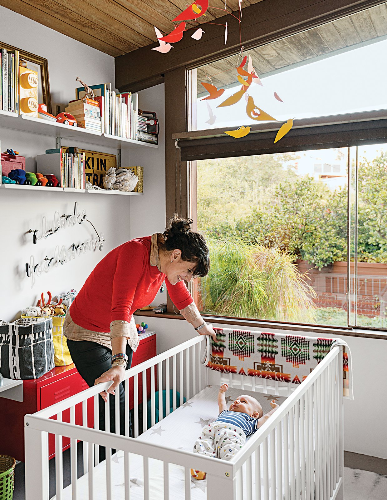 Baby Max's bedroom (in his parents' Los Angeles A. Quincy Jones house) is outfitted with a Gulliver crib and a red PS cabinet, both from Ikea, as well as a Birds in Harmony mobile by Christel Sadde and Katsumi Komagata for the Museum of Modern Art Store. The custom