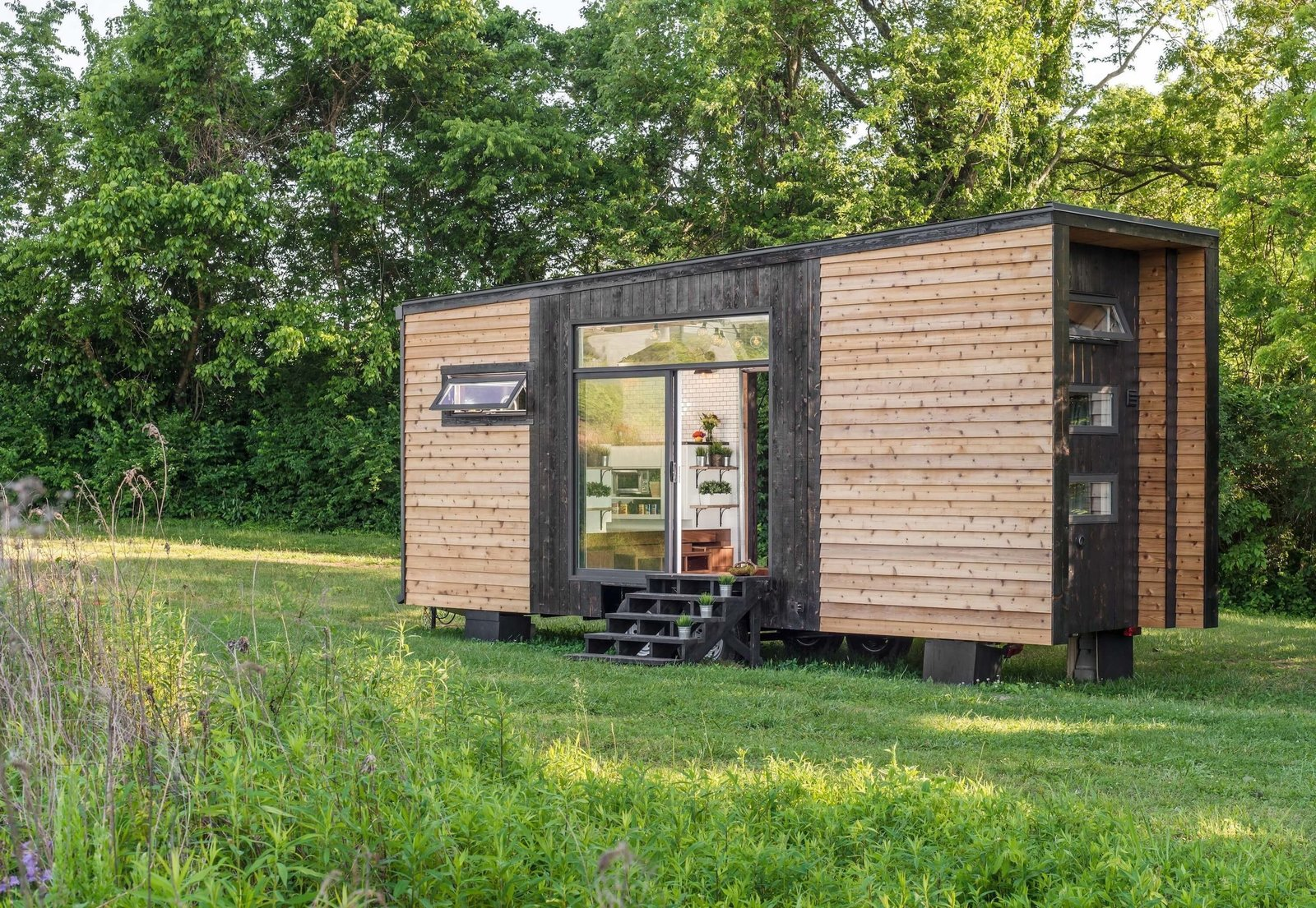 New Frontier Tiny Homes's Alpha, is one of the fanciest tiny homes around. The 240-square-foot modern design is super functional and good looking to boot. They also have a larger model, Escher, a model that at around 300 square feet, is more spacious and offers two bedrooms.