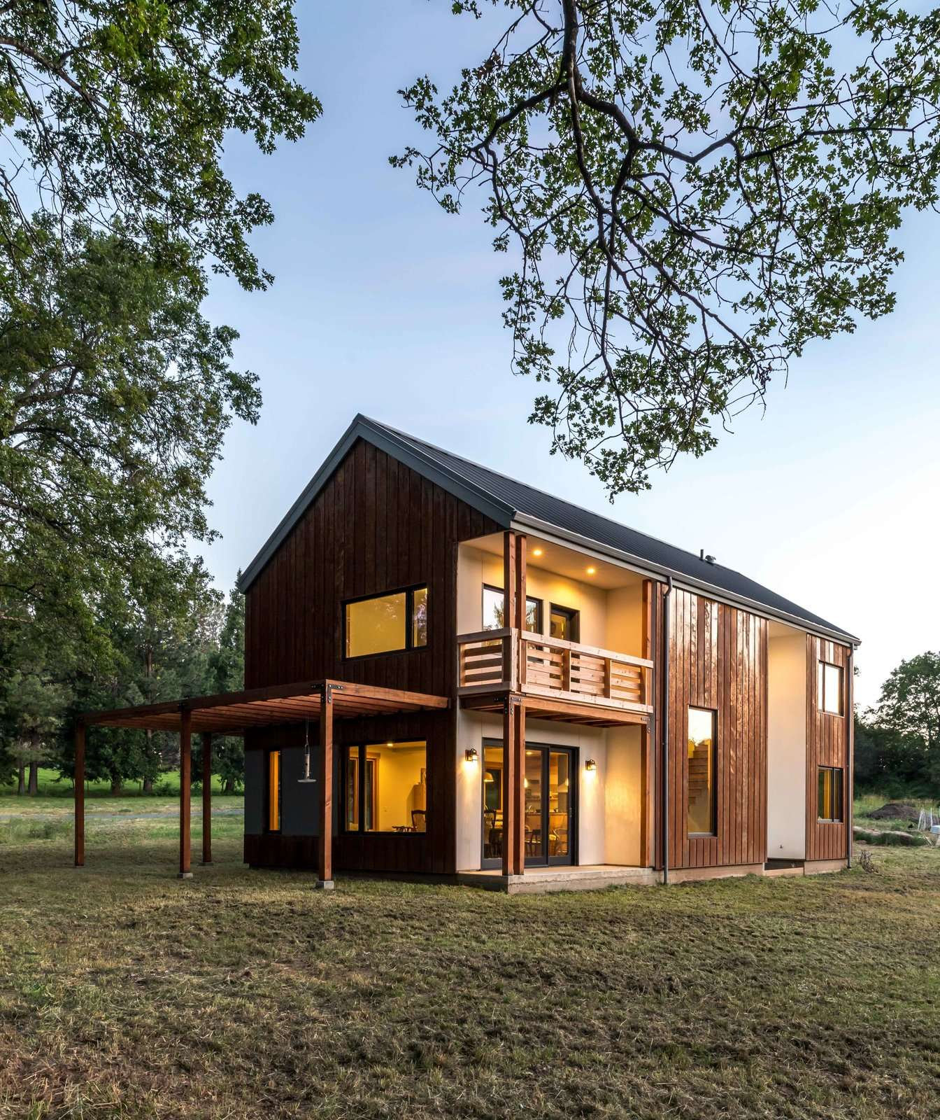 The simple, gabled structure of Meadow View is strategically cut away to both protect doorways and to provide a balcony off the master bedroom.