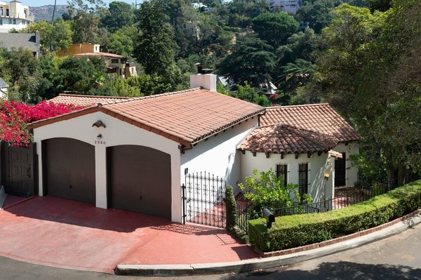 Aside from the carriage-house-style two-car garage, much of the 2,150-square-foot home is hidden from street view, creating a private oasis within the coveted area of Beachwood Canyon.