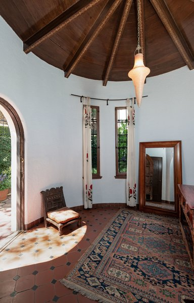 Upon arrival, a tall rotunda entry with unique gold stenciling leads to the home's living areas.