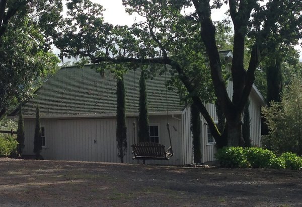 Before: The tack barn was originally 936 square feet. The redesign created an 839-square-foot living space connected to a 107-square-foot screened porch.