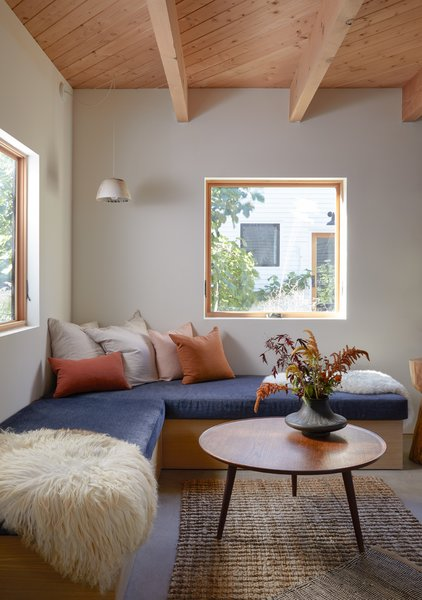 The ceramic pendant above this cozy corner bench is by local studio Notary Ceramics; the wood table is by Vince Skelly.