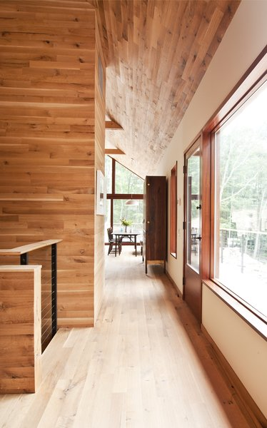 Walls, ceilings, and floorings are clad in warm white oak sourced from a small mill in Pennsylvania.