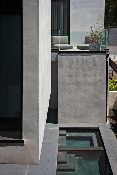 Overlooking the pool is a relaxing seating nook.