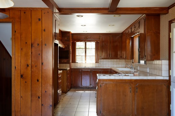 The abundance of dark wood in the kitchen—from the ceiling, to the cabinetry, to the walls—took the mountain setting too literally.