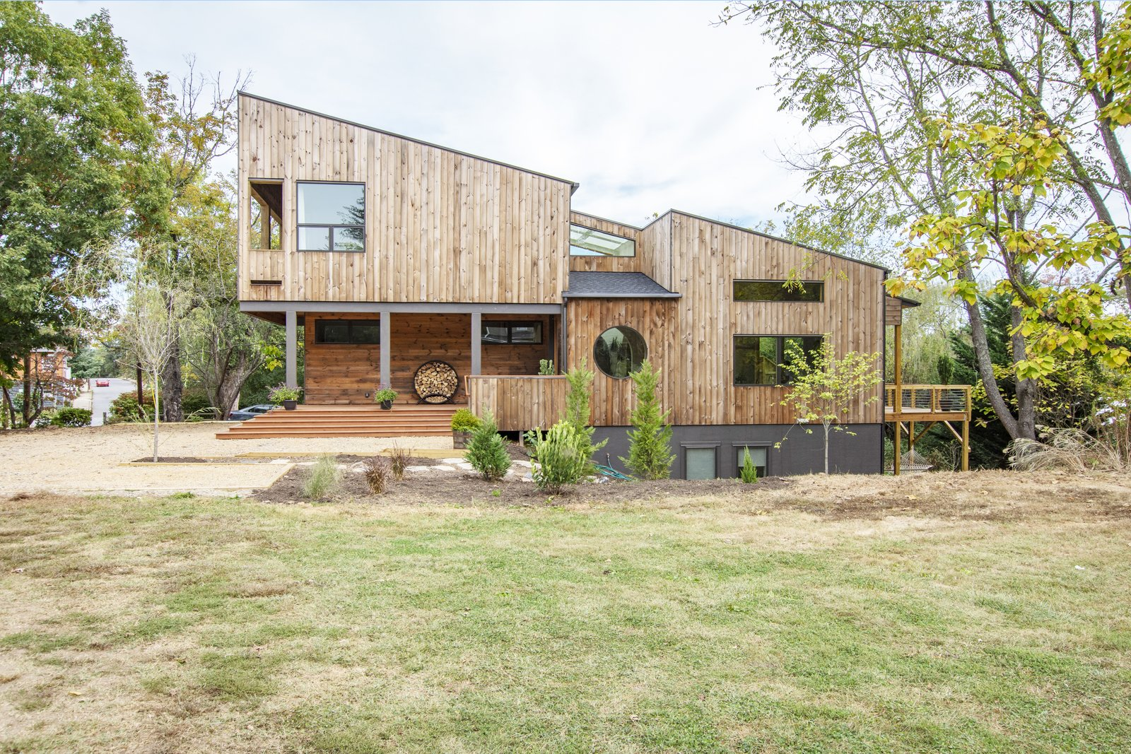 Locally milled cypress siding, a naturally rot resistant wood, will darken over time.