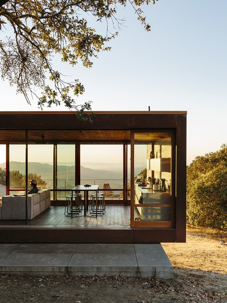 An exercise in simplicity, the minimalist Sonoma weeHouse features two steel-framed weathering steel volumes with ipe interiors, oiled oak cabinetry, and massive sliding glass walls that overlook valley views.