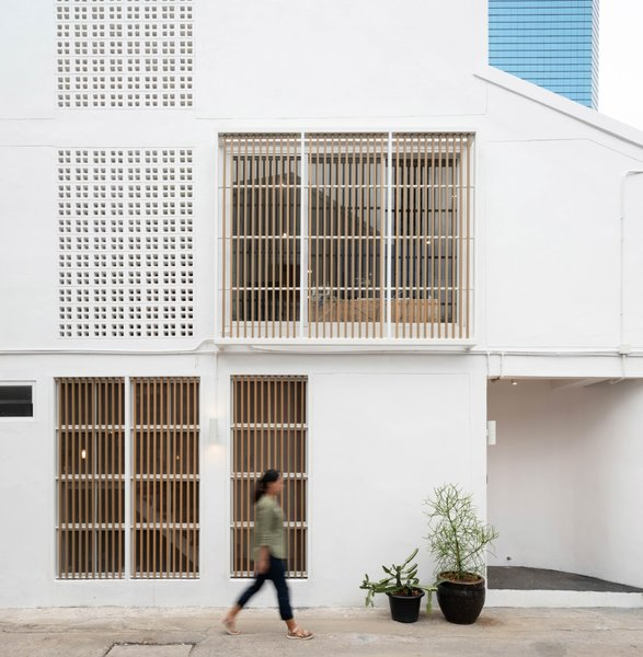 Composite wood louvers shield the interior from unwanted heat gain and provide privacy from the street.