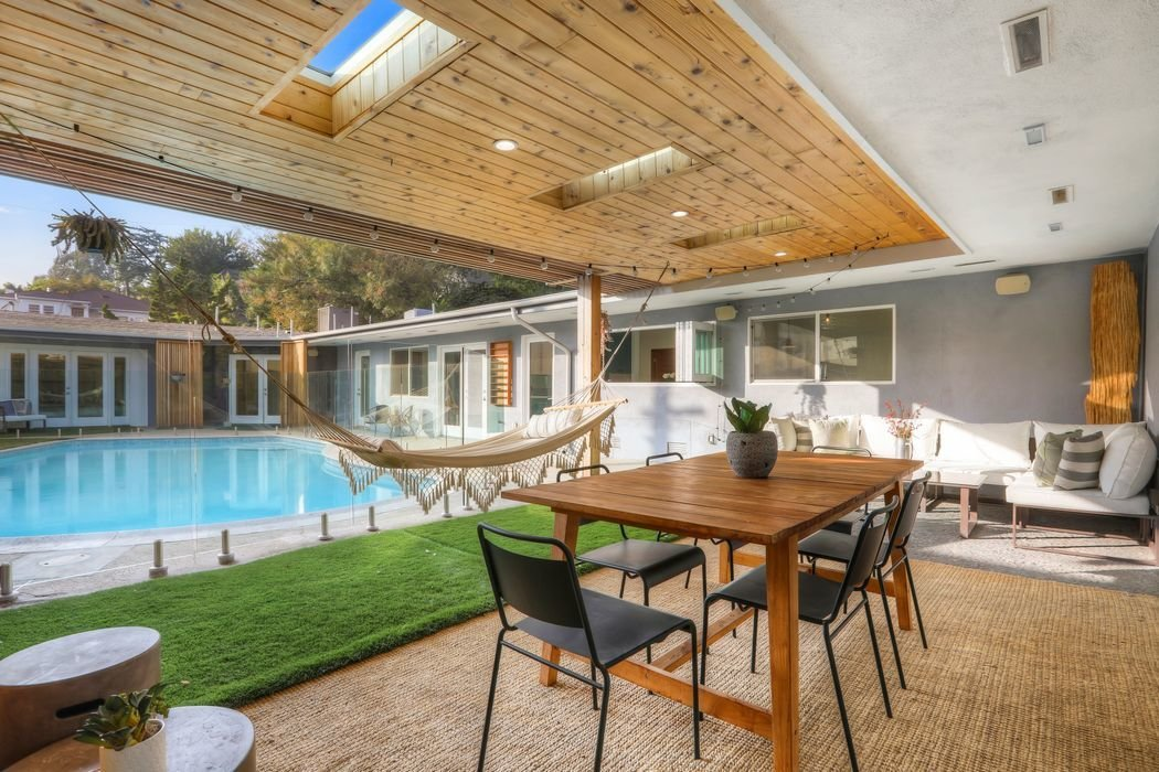 Steps away from the kitchen is a covered outdoor eating area that offers a cabana-like vibe.
