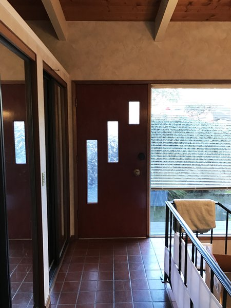 Before: Dated tile and ironwork dominated the entry before.