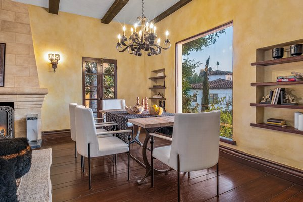 Set next to the living room, the dining area offers direct access to the home's lush backyard. An oversized picture window invites an abundance of natural light inside.