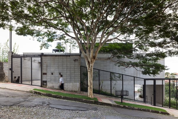 The home sits on a sloped site and has two entrances on the street side – one on the upper level to the residence, and one on the lower level to the wine tasting room.