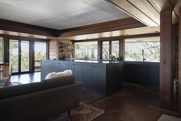 Originally built by Walter Thomas Brooks in 1962, this Napa abode received a breath of fresh air in the form of a new kitchen by Henrybuilt. Maintaining its connection to the living and dining areas, the room is anchored by an island with leather pulls. Its pared-down look, in harmony with the other spaces, is defined by minimal open shelving, built-in storage, and refined matte finishes.