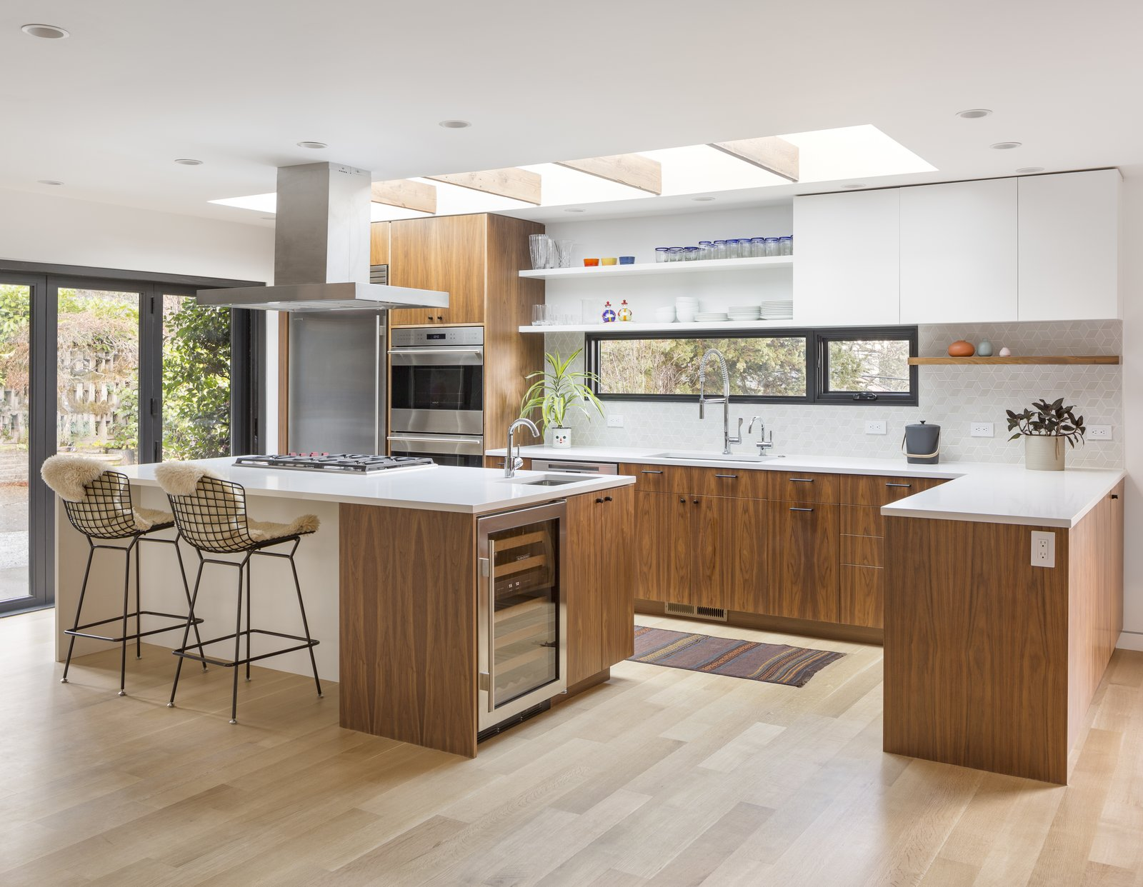 """Portland-base pastry chef Andrea Nicholas purchased a 1953 midcentury ranch whose 2,500 square feet needed """"a lot of TLC."""" Nicholas hired architect Risa Boyer to design the renovation, which involved opening up the kitchen to the dining room and creating a contemporary open-plan living space."""