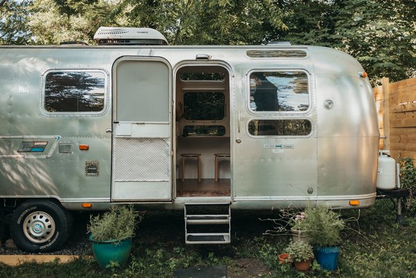 After spending 18 months rehabbing their 31-foot-long Airstream, the couple took it on the open road, traveling out west with their dog.