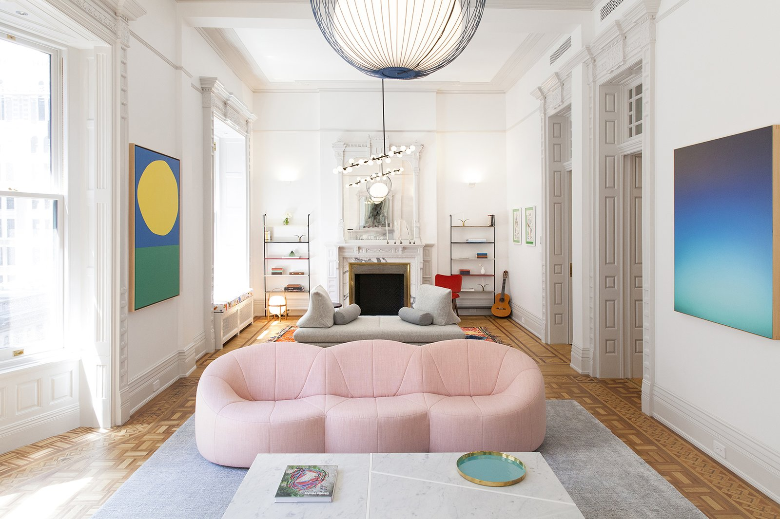 The curvy shape of this pink sofa gives it a fun, playful quality.