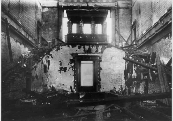The staircase in November 1943, after the bombing. Following the war, the building was left exposed to the elements, which did further damage. The plaster figures seen here were not salvageable.