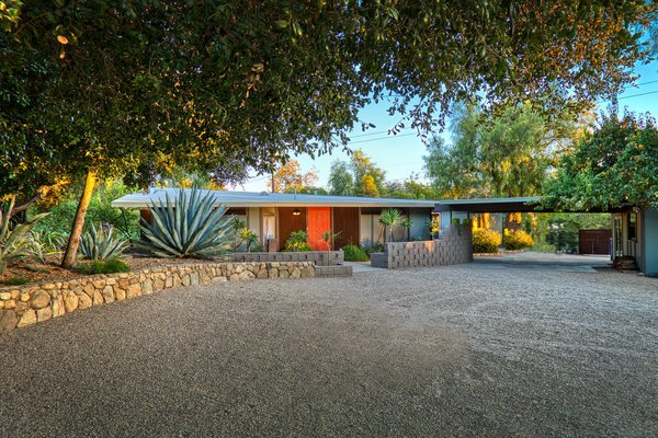 Shaded by trees, this remodeled 1960s home in Ojai fits perfectly with the area's laid-back vibe. The single-story home was carefully restored by its current owners to celebrate midcentury modern design.