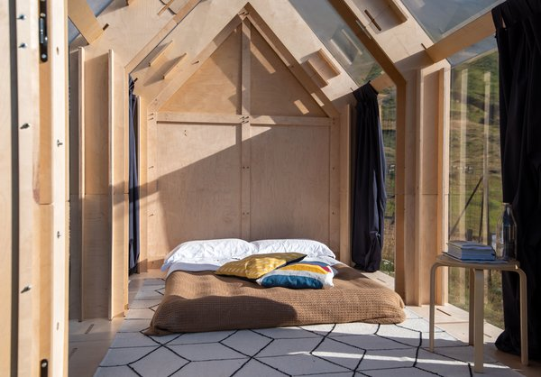 The chic, minimalist interiors sleep two and have a slightly rustic feel. There is only room for a double bed and a small stool.