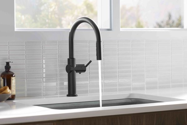 The Kohler Crue Collection. The mega company's brand introduced the Crue collection of sleek, gooseneck faucets that integrate motion sensors for hands-free operation. But the real story here is that the pull-down model is available with Kohler Konnect, the company's voice-activation app. No need to grab the measuring cup—like U by Moen, Crue can dispense precise amounts of water at desired temperature.