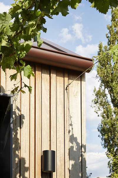 The new addition is clad in timber. Its texture plays with shadow and depth much like traditional weatherboards.