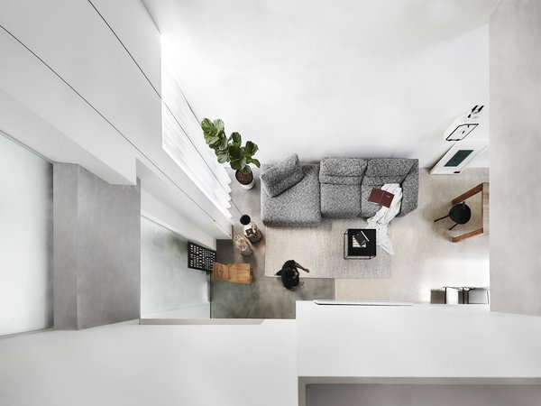 The Loft Box is on the top floor of an '80s walk-up apartment. The removal of false ceilings allowed Cheok to insert an attic that overlooks the living and dining spaces.
