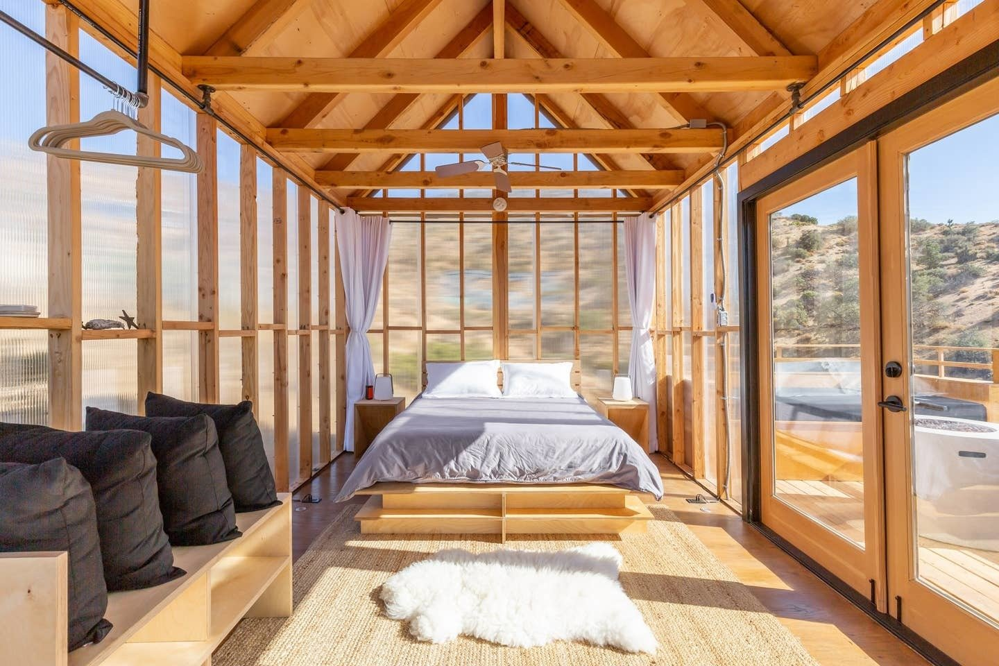 The walls of this contemporary one-room cabin are covered in insulating polycarbonate siding.