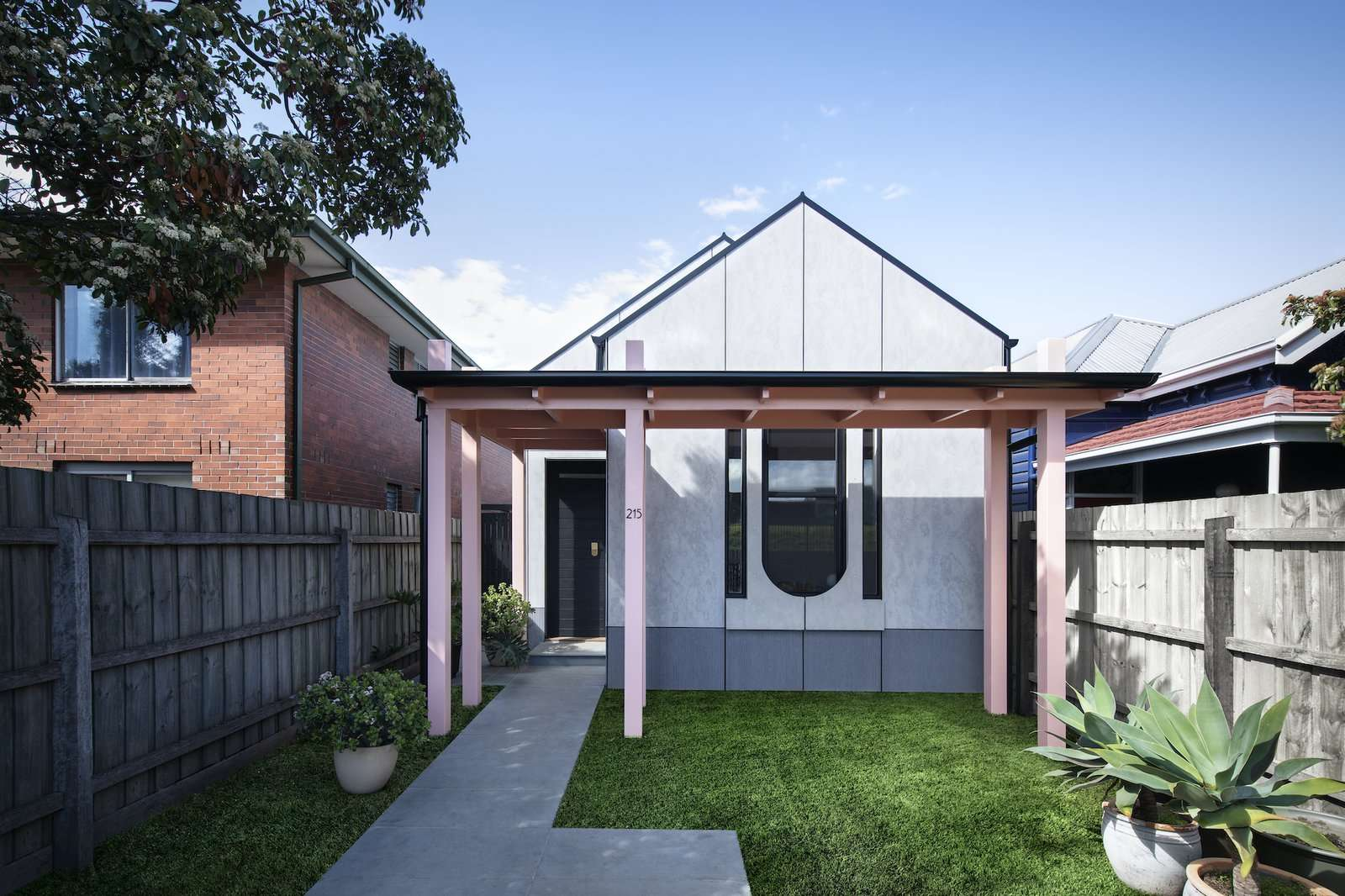 The form of the house references the original Edwardian dwelling. The vibrant color palette and graphic windows bring a sense of playfulness to the home.