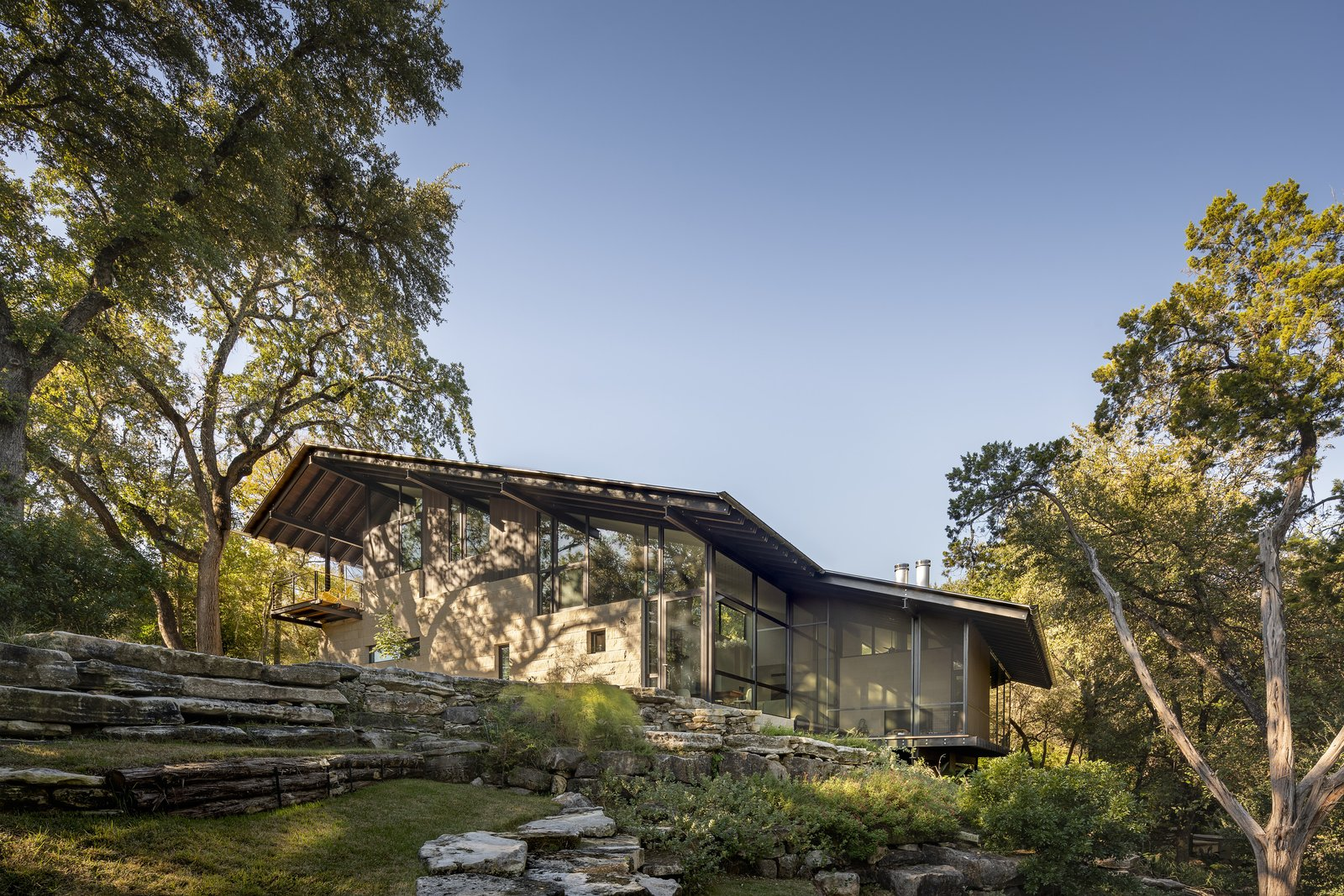 A path of restored rock ledges leads to a dry creek, amphitheater, and private gathering space.