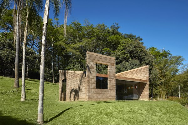 Architect Gustavo Penna designed a 484-square-foot sustainable home in Brazil using glass and blocks made from mining waste and concrete.