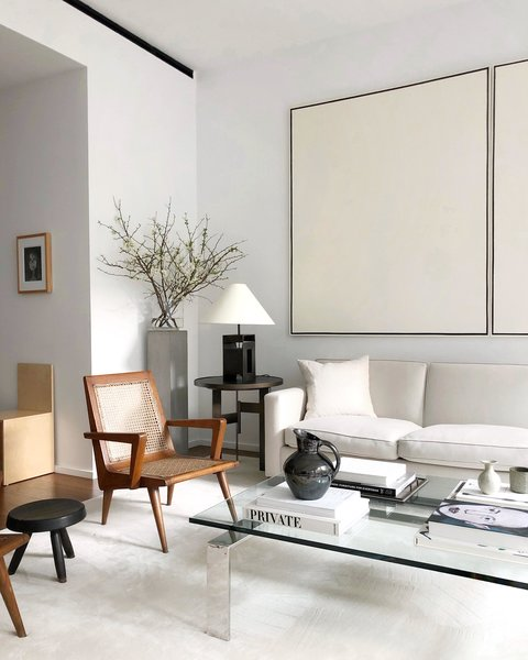 Alyssa Kapito's living room has been edited and integrates pieces with texture and scale to add warmth and depth to an otherwise airy space.