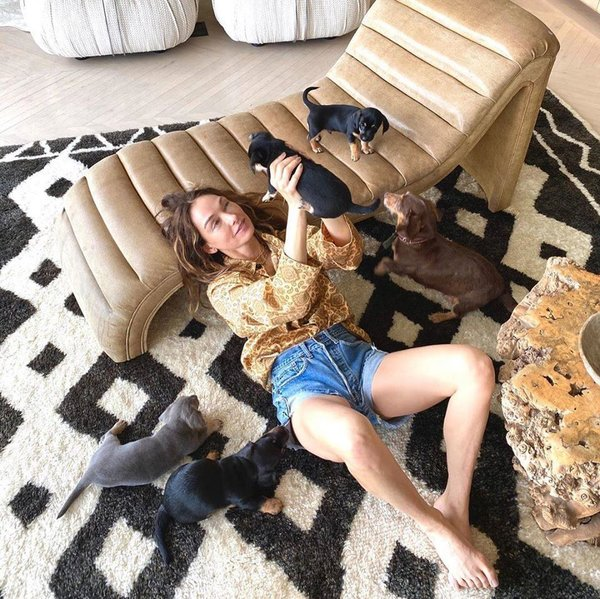 Kelly Wearstler at home in Beverley Hills. The living room lounging chair, coffee table, and carpet can be easily repurposed for other parts of the home.