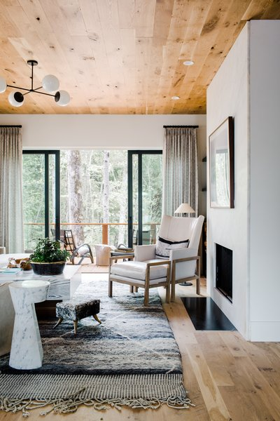 White walls allow for the natural light to really illuminate the space while soft colors prevent the space from looking one-dimensional. The living room features a Minimalist Nordic hearth by Gault Designs