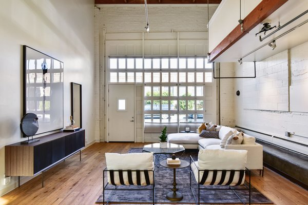 The series of small windows climbing up the front facade ushers ample light inside the home.