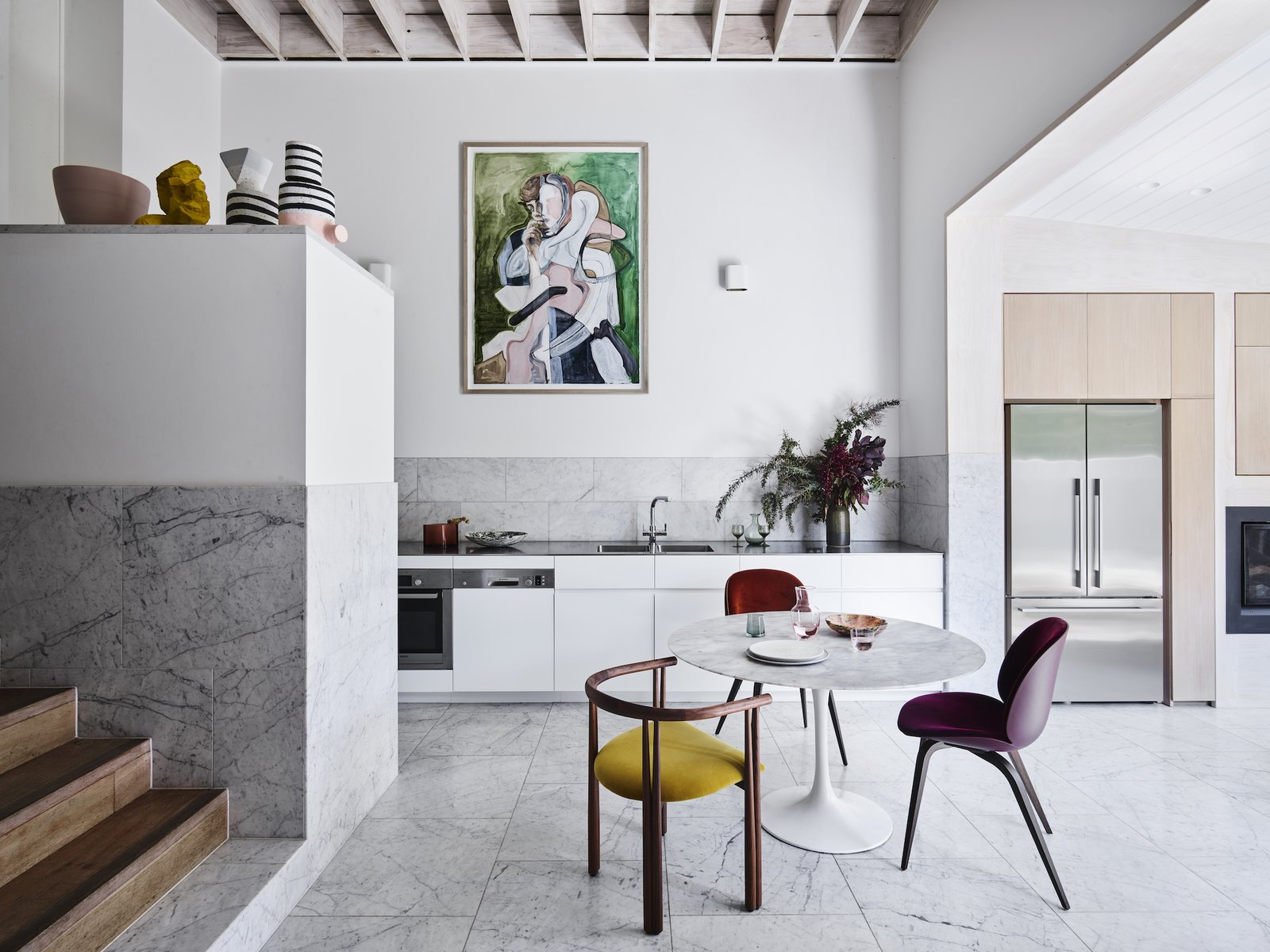 The home's philosophy was inspired by the works of Alvar Aalto and Louis Kahn. The use of locally available and low-cost pine and Carrara stone gives it an almost Scandinavian sensibility, which the couple describe as