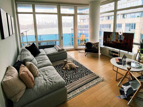 Overlooking the East River, Jeremiah Maestre's living room is ready to host a virtual training session.