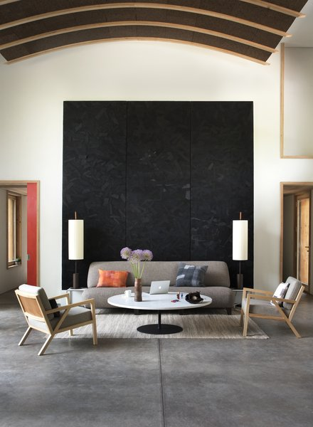 The fabric wall art and pillows in the living room are by Designwork, a zero-waste textile project crafted from recycled Eileen Fisher clothing.